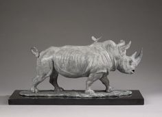 #Bronze #sculpture by #sculptor Camilla Le May titled: 'Sudan, the last male northern white rhino with an oxpecker'. #CamillaLeMay