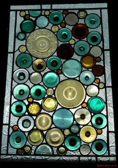 "recycled glass art Bottle bottoms and more... ""Each panel contains vintage/antique glass from chandeliers, lamp parts, you name it. I am always scouring the antique stores and flea markets. I then foil each and every piece with copper foil and solder the panel on both sides. I use old window frames that I've also collected and replace the glass with the artwork I create."" By Alison Fox: alisonsstainedglass.com"