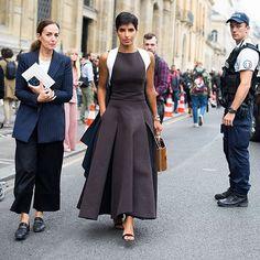 Pleats, please: outside the Chalayan show, a long dress on Deena Aljuhani Abdulaziz gets more volume from kick pleats. Photo by @gastrochic #PFW #fashion #streetstyle