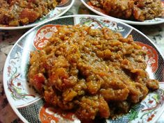 Moroccan zaalouk is a delicious cooked salad made with eggplant (aubergines), tomatoes, garlic, olive oil and spices. It's usually served as a dip with crusty bread.