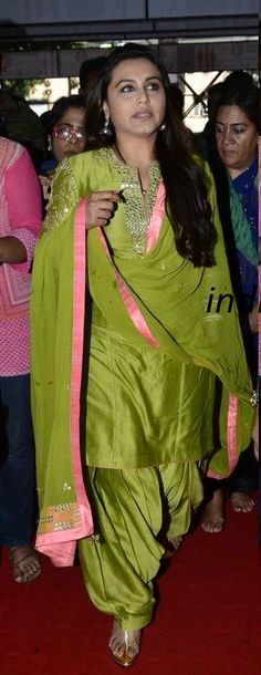 Rani Mukherjee in green color raw silk short salwar kameez with patiala bottom with simple v cut and green dupatta with pink border.