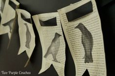 This is so perfect for Halloween! Raven silhouettes painted onto book pages and turned into a cute banner. via www.twopurplecouches.com
