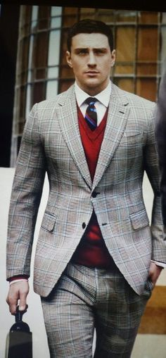 Men's Red V-neck Sweater, White Dress Shirt, Black Tie, Grey Plaid Blazer, Grey Plaid Dress Pants, and Black Leather Briefcase