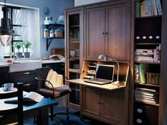 Ikea workspace.  Hemnes secretary w/add-on unit from desk collection and Hemnes shelves from living room collection.