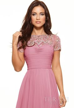 Cap sleeve gown with mock sweetheart bodice and mesh chest embellished with an array of crystals and sequins