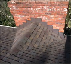 Understanding your Residential Roof Replacement Estimate #7: Chimney Crickets