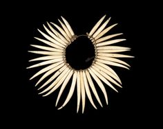 Necklace | Fiji.  Mid 19th century | Sperm whale ivory, plant fibers and brass.