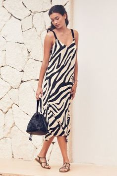 Our midi-length slip dress is perfect for holidays or lazy days in the sunshine, styled in a relaxed fit with a V-neck and delicate cami straps. Choose your favourite colour. or simply buy them all! Slip Dress Outfit, Black Slip Dress, Dress Outfits, Party Dresses For Women, Summer Dresses, Knee Length Dresses, Zebra Print, Evening Dresses, Style Inspiration