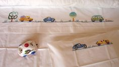 embroidered crib sheet and pilowcase vintage cars via Andreia, a Naïf. Click on the image to see more!