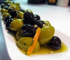 Spiced Olives With Herbes De Provence & Citrus  Spiced Olives With Herbes De Provence & Citrus Recipe spiced warm olives #provence #france #tourisme #tourisme #south #paca #pacatourism #pacatourisme #tourismepaca #tourismpaca #food #olive #olives #herbes #herbs
