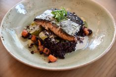 Grilled salmon is served over organic venere black rice, roasted seasonal vegetables and with a greek yogurt sauce. Greek Yogurt Sauce, Barcelona Restaurants, Spicy Tomato Sauce, Black Rice, Vegetable Seasoning, Grilled Salmon, Organic Vegetables, Roasted Sweet Potatoes, How To Make Cake