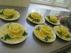 These Lemon Flowers would be lovely on a cold seafood appetizer plate.Lemon Roses for Ladies TeaTop a whole lemon cake in lemon rosesThese Lemon Flowers will be Great to Garnish Your Food. Bridal shower idea for a tea party. Lemon Flowers, Fruit Flowers, Edible Flowers, Cuisine Diverse, Fruit And Vegetable Carving, Food Carving, Food Garnishes, Garnishing Ideas, Food Displays
