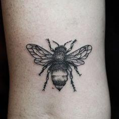 Grey Ink Bee Tattoo On Wrist