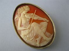 A Victorian silver and carved shell cameo brooch.