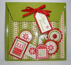 "Tomorrow I have a Stampin' Up workshop and as a thank you to Cathy the hostess I made her a Christmas tag pouch with a few tags inside. All you have to do is use a 6""x6"" clear page protector for a scrapbook and cut the binding off the side where the holes are and tape it to a 6 1/2"" x 8 1/2"" piece of card stock, score at the 6 1/2"" end at 2"" for the fold down flap, punch some holes for ribbon and you've got yourself a tag pouch. For the inside I used Stampin' Up's Dashing designer Christmas…"