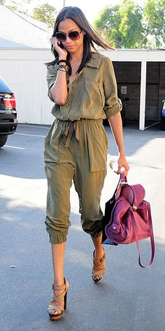 Zoe Saldana in a Bird by Juicy Couture jumpsuit and Ann Taylor heels. Love those heels and the casual vibe of the jumpsuit with a pop of color in the bag.