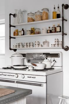 Industrial shelves over the stove