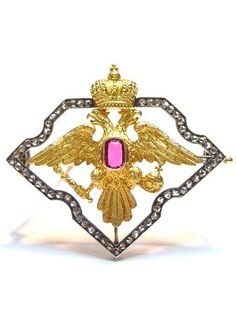 Fabergé. Brooch formed as a finely chased yellow gold Imperial Double-headed eagle mounted with a ruby shield held within a frame of rose diamonds. Work-master: Alfred Thielemann. 1908 – 1917.