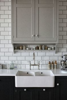 pale grey cabinet uppers, shaw sink, grey grout in subway tile