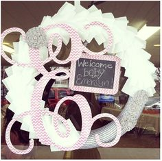"This would be one fun ""nesting"" craft project for the mommy to be! Love this DIY wreath for the hospital door, welcoming the new addition. The mini-chalkboard is perfect for writing in the baby's birth weight & height as well. So pretty, you could even use on the nursery door after you bring baby home!"