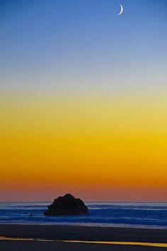 Hug Point and a crescent moon on the Oregon Coast