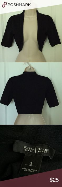 """WHBM black shrug bolero sz SMALL Black shrug from WHITE HOUSE BLACK MARKET  Size SMALL  Bust (underarm to underarm - UNSTRETCHED): 34""""  Bust (underarm to underarm - STRETCHED): up to 40""""  Length (shoulder to hem): 15.5""""  Sleeve length ( shoulder to cuff): 11""""   Edge to edge front. 77% silk, 20% nylon, 3% spandex.  In excellent gently used condition.  FROM A SMOKE FREE HOME. White House Black Market Sweaters Shrugs & Ponchos"""