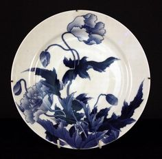 Hirado Ware. Antique Japanese porcelain plate. Hand painted underglaze in shades of blue showing Poppy and leaves. 24 cm diam.