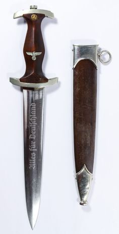"""Lot 358: World War II German SA Dagger ; Having the """"Soligen"""" mark on the engraved blade and the sheath with hanger ring"""