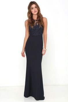 Like a beautiful meadow lark, you'll make a sweeping entrance in the Oak and Elm Navy Blue Lace Maxi Dress! A rounded neckline and sheer lace decolletage join a sleeveless, sweetheart bodice, complete with flattering princess seams. Fitted waist introduces an elegant woven maxi skirt, for a silhouette that is sure to stun. Hidden back zipper with clasp.