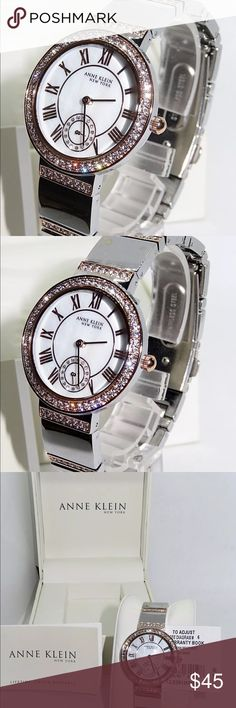 "Anne Klein NY Women's Two Tone Rosegold Watch Silver-tone case and bracelet Rosegold-tone bezel and link accents Swarovski crystals surround the bezel and accent the bracelet White mother-of-pearl dial Rosegold-tone hands and hour markers Roman numeral hour markers Seconds sweep Will fit a wrist up to: 7 1/2"" Face width with crown: 1 7/16"" Case size: 33mm Dial diameter: 1 1/16"" Case thickness: 1/4"" Bracelet width: 5/8"" Push-button deployment clasp Water resistant 100ft MSRP: $195.00 Anne…"