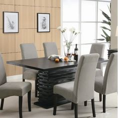 Dining room sets have both 6 and 8 seats, rectangular or square, bar height option, both grey and green chairs. Maybe we could buy matching bar stools for the island.