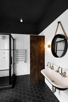 Like the idea of the glass shower framed in black metal to add an industrial flair