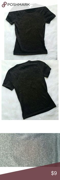 Black Metallic Top Black with silver metallic/glitter top Issac Mizrahi for Target. Short sleeve. Can be dressed up or down. Simple piece with just enough to add a little extra to your outfit. Issac Mizrahi for Target Tops Tees - Short Sleeve