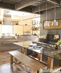 The stainless steel glows in the northern light, but it's the fireplace that keeps you warm in this Mammoth Lakes, California, kitchen