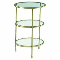 """Featuring 3 clear tiers for family photos or your favorite trinkets, this sleek accent table effortlessly pairs timeless style with practical purpose.  Product: Accent tableConstruction Material: Glass and metalColor: Gold and clearFeatures: Three tiersDimensions: 26"""" H x 15"""" W x 17"""" D"""