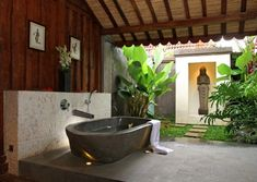Semi-outdoor bathroom with its own Zen nook. Remember that an outdoor bathroom that is standing just outside the master bedroom needs to feel like an extension of the space indoors. ➤To see more Luxury Bathroom ideas visit us at www.luxurybathrooms.eu #luxurybathrooms #homedecorideas #bathroomideas @BathroomsLuxury