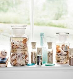 Scoop up sand and shells into pretty little bottles and label. Way better than silly little souvenirs from the gift shop!