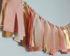 "Blush pink and gold  Fabric ""rag"" garland - Corinne needs this to hang above her crib! Now  to figure out how..."