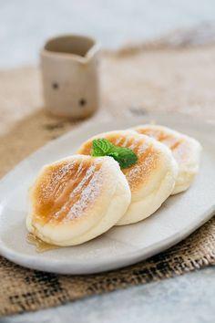 three souffle pancake on an oval shped plate