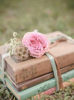 Books as centerpieces. Topped them differently but they looked good.