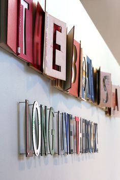 This would look cool in my office! Cut out letters in books and spell out a word.