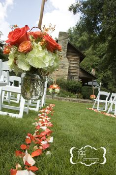 Aisle flowers mason jars outdoor country wedding