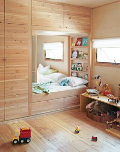Love the book shelf behind the bed. Kids room: Only a set of sliding doors separates the kids' room from the master bedroom in a Toronto, Ontario, home. When the time is right, there's a track inlaid in the ceiling for a four-panel bifold wall to divide the space into two private rooms for the children.