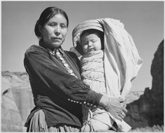 Navajo Woman and Infant, Canyon de Chelle, Arizona. Canyon de Chelly National Monument, 1933 - Ansel Adams, public domain via Wikimedia Commons. Ansel Adams, Native American Women, Native American Indians, American Children, American Spirit, Black White Photos, Black And White Photography, Wild West, Navajo Women