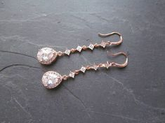 Rose gold tear drop earrings made with rose gold plated brass and cubic zircon connectors. This is a beautiful earring that makes a statement with its extremely elegant design. Very versatile, perfect for any special occasion or for a bride or even as a gift for bridesmaid or mother of the bride. #rosegoldearrings #weddingearrings #bridalearrings