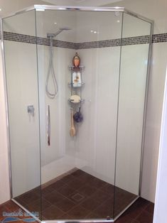 I really like the simple, frameless look of this shower door. I like the dark colored tile as well, that would probably not show dirt as much. My husband and I are remodeling our bathroom, so we'll have to consider a shower layout like this. Shower Screen, Custom Shower, Color Tile, Shower Doors, Family Business, Montage, Layout, Simple, Remodeling