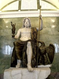 """The seated statue, some 12 meters (43 feet) tall, was so large that """"if Zeus were to stand up he would hit the roof of the temple it was housed in"""". Description from pinterest.com. I searched for this on bing.com/images"""