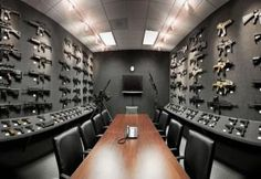 Guns, guns, guns! I will have this room one day... then ill be ready for the zombies! MUAHAHAHAHA!!! It will be mine, oh yes it will be mine!