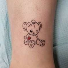 tiny ragged teddy bear tattoo