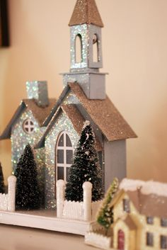 LOVE these little Christmas houses! Made with cardboard?